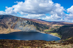 Mountain lake Lough Tay in Wicklow Mountains Ireland Royalty Free Stock Image