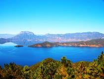 Mountain lake, Lugu Lake. A beautiful mountain lake at Sichuan Lugu Lake Royalty Free Stock Photography