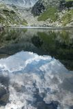 Mountain lake mirror reflecting the beautiful summer sky. In Bucegi Mountains, Romania Royalty Free Stock Photography