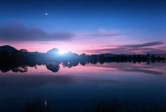 Mountain lake with moonrise at night. Night landscape Royalty Free Stock Images