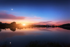 Mountain lake with moonrise at night. Night landscape Stock Photography