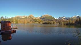 Mountain lake in morning light stock video