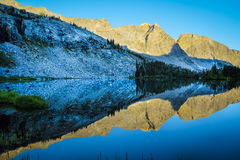 Mountain lake and morning reflections Royalty Free Stock Images