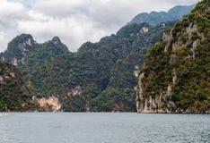 Mountain lake. The mountains around the reservoir Khao sok. Thailand Stock Photos