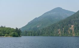 Mountain lake in mountains at day time British Columbia Canada. Royalty Free Stock Photos