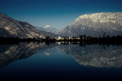 Mountain lake. Mountains and sky reflected in a lake, wide angle image Royalty Free Stock Image