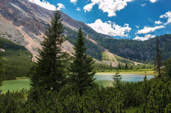 Mountain lake. Moutain lake surrounded with heath and steep slopes Royalty Free Stock Image