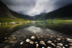 Mountain lake near Eggum in Lofoten islands. Summer in Norway royalty free stock photos