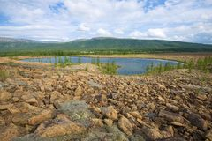 The mountain lake in the neighborhood of the river Sob. Polar Ural Mountains, Russia. The mountain lake in the neighborhood of the river Sob. Polar Ural stock images