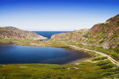 Mountain lake in the North. Moss-covered hills, and stunted vege Royalty Free Stock Photo