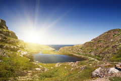Mountain lake in the North. Moss-covered hills, and stunted vege Royalty Free Stock Images