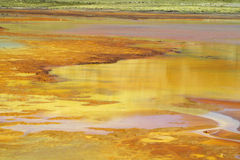 Mountain lake with orange metal color water Stock Photo