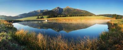Mountain lake panorama - Slovakia Tatras at sunrise royalty free stock photo