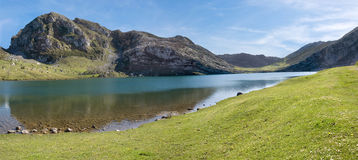 Mountain and lake (panoramic). Mountain and lake of the region Asturias in Spain (panoramic Royalty Free Stock Photo