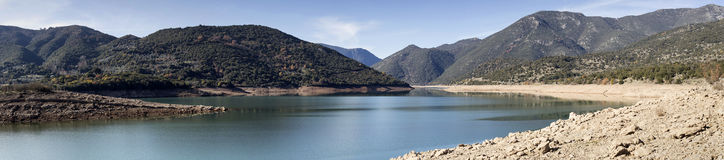 The mountain lake. The panoramic view of mountain lake and mountains Royalty Free Stock Photo