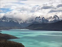 Torres del Lake, Patagonia, Chile. The snow and glacier covered mountain peaks of the remote Paine Massif in Torres del Paine National Park, Chile, from Lago Stock Photos