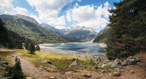 Mountain lake and path in the Pyrenees in the south of France Royalty Free Stock Photos