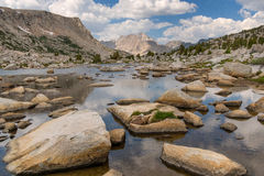 Mountain lake with peak in distance Royalty Free Stock Photography
