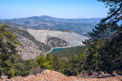 Mountain lake among picturesque ocher slopes of the Troodos Royalty Free Stock Photography