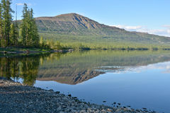 Mountain lake in the Putorana plateau. Royalty Free Stock Images