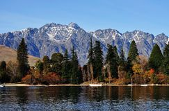 Mountain and lake in Queenstown. View of The Remarkables mountain in Queenstown royalty free stock image