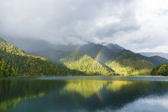 Mountain Lake and rainbow Stock Image
