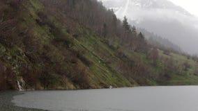 Mountain Lake on a Rainy Day stock footage