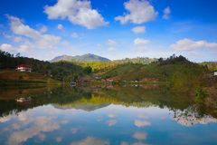 Mountain lake. With reflect clouds Stock Image