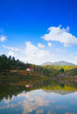 Mountain lake. With reflect clouds Stock Photos