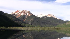 Mountain Lake Reflection Zoom out. A scenic reflection in a Colorado mountain lake zoom out stock video