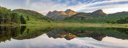 Mountain lake reflections. Stock Photos