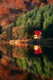 Mountain lake reflexion. View of a chalet reflected in a mountain lake Stock Image