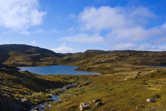 Mountain lake on the ridge Musta Tunturi Royalty Free Stock Image