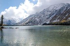 Mountain lake with a ridge of rocks stock photo