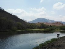 MOUNTAIN LAKE RIVER AND HORSE LANDSCAPE stock photography