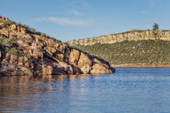 Mountain lake with sandstone cliffs Stock Images