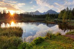 Mountain lake in Slovakia at sunset - Strbske pleso Stock Photography
