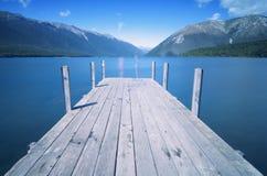 Lake Jetty - Lake Roititi, Tasman District. A mountain lake in between St. Arnaud Range and Robert Ridge. Popular place for leisure among families Stock Photos