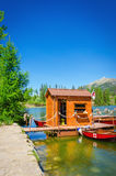 Mountain lake Strbske pleso and red boats Slovakia Royalty Free Stock Images
