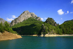 Mountain lake in the summer. Mountain lake with blue sky in the summer Stock Image