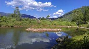 Mountain Lake summer. Hiking Stock Photo