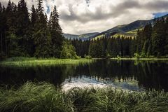 Mountain lake during summer. Surrounded by hills in Slovakia Stock Photography