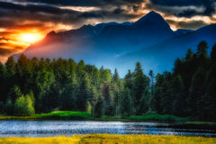 Mountain lake with the sun Royalty Free Stock Image