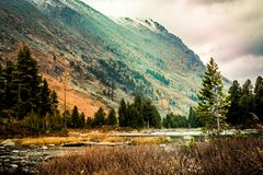 Mountain lake on a Sunny day. Autumn weather in the mountains stock images