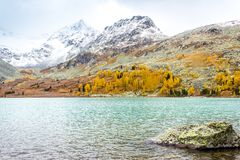 Mountain lake on a Sunny day. Autumn weather in the mountains. The peaks of the rocks. Walking tour in a mountain valley royalty free stock images
