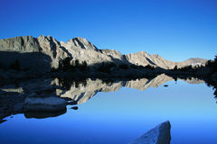 Mountain lake at sunrise. View of the mountain accross a quiet lake just before the sun rises Royalty Free Stock Photo
