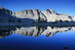 Mountain lake at sunrise. View of the mountain accross a quiet lake just before the sun rises Stock Photography