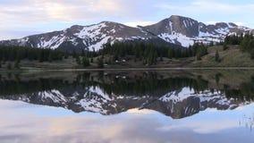 Mountain Lake Sunrise Reflection. A scenic sunrise reflected in a Colorado mountain lake stock footage