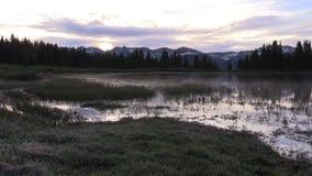 Mountain lake at sunrise. A scenic sunrise reflected in a Colorado mountain lake stock video