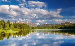Mountain lake at sunset Stock Images